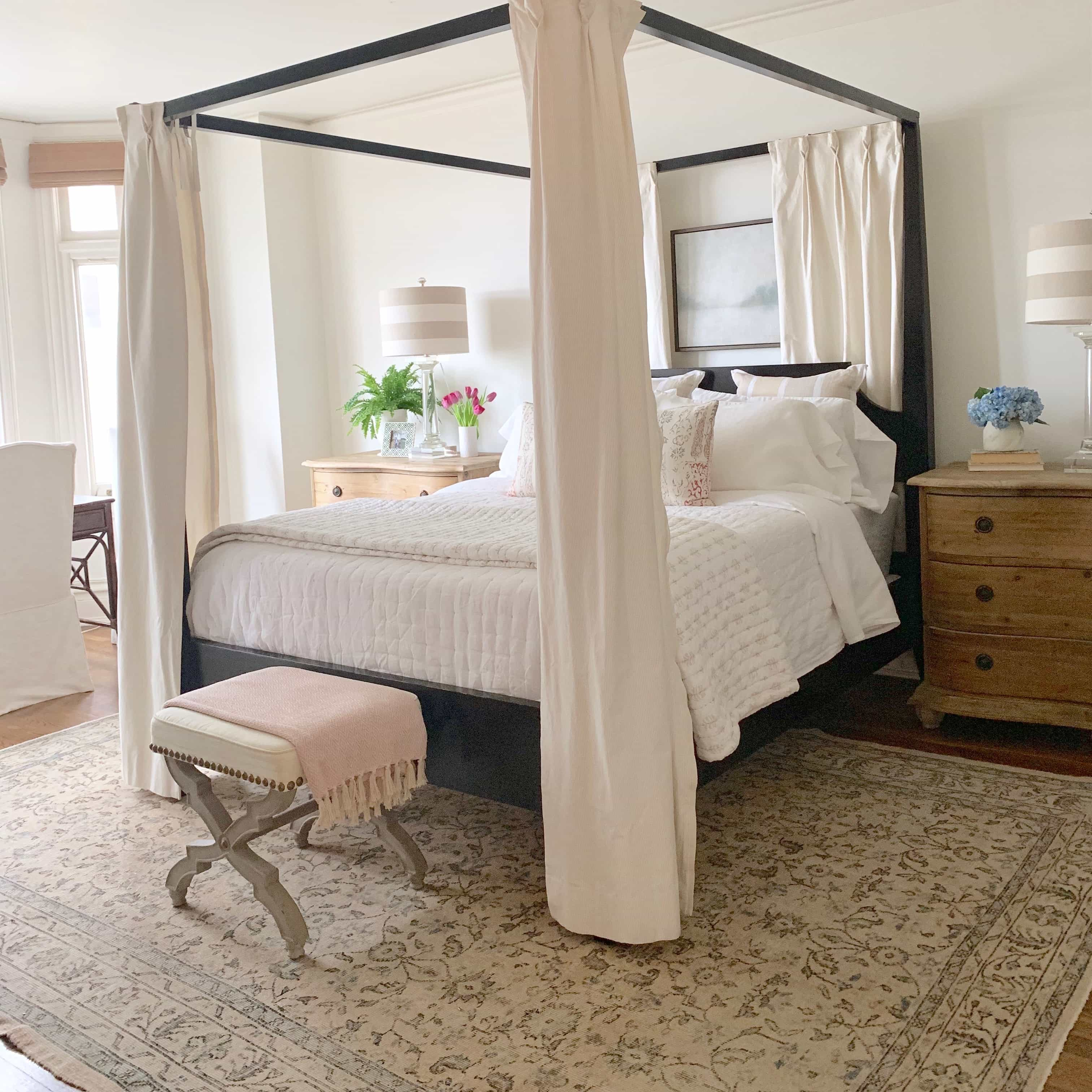 four poster bed, bench, chest with lamp