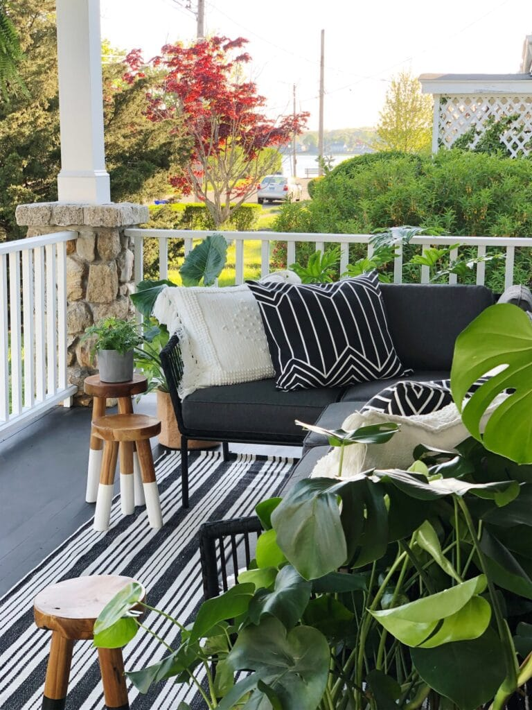 porch with pillows, stools, plants