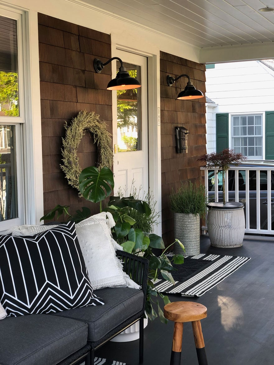 front door, sconces, barn lights, planters, pillows