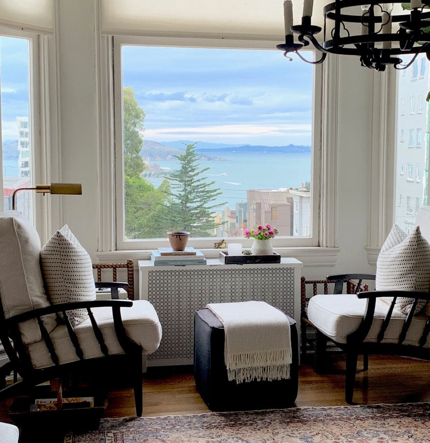 pair of chairs and ottoman with views from window