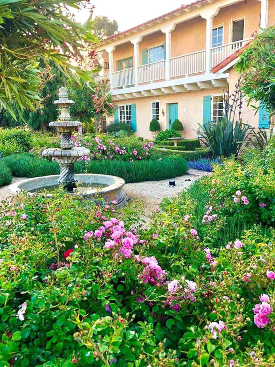 garden, fountain, house with green shutters