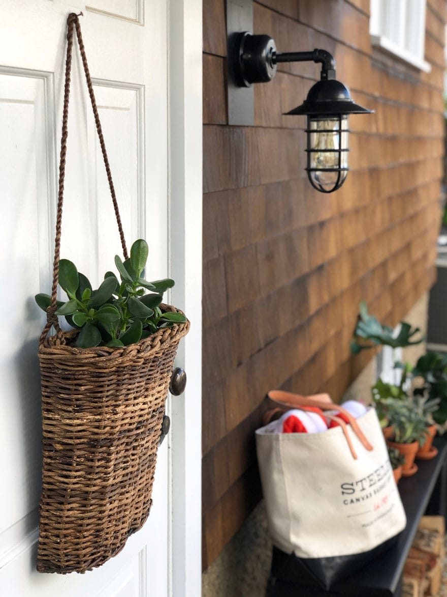 basket on door, light, bench with bag