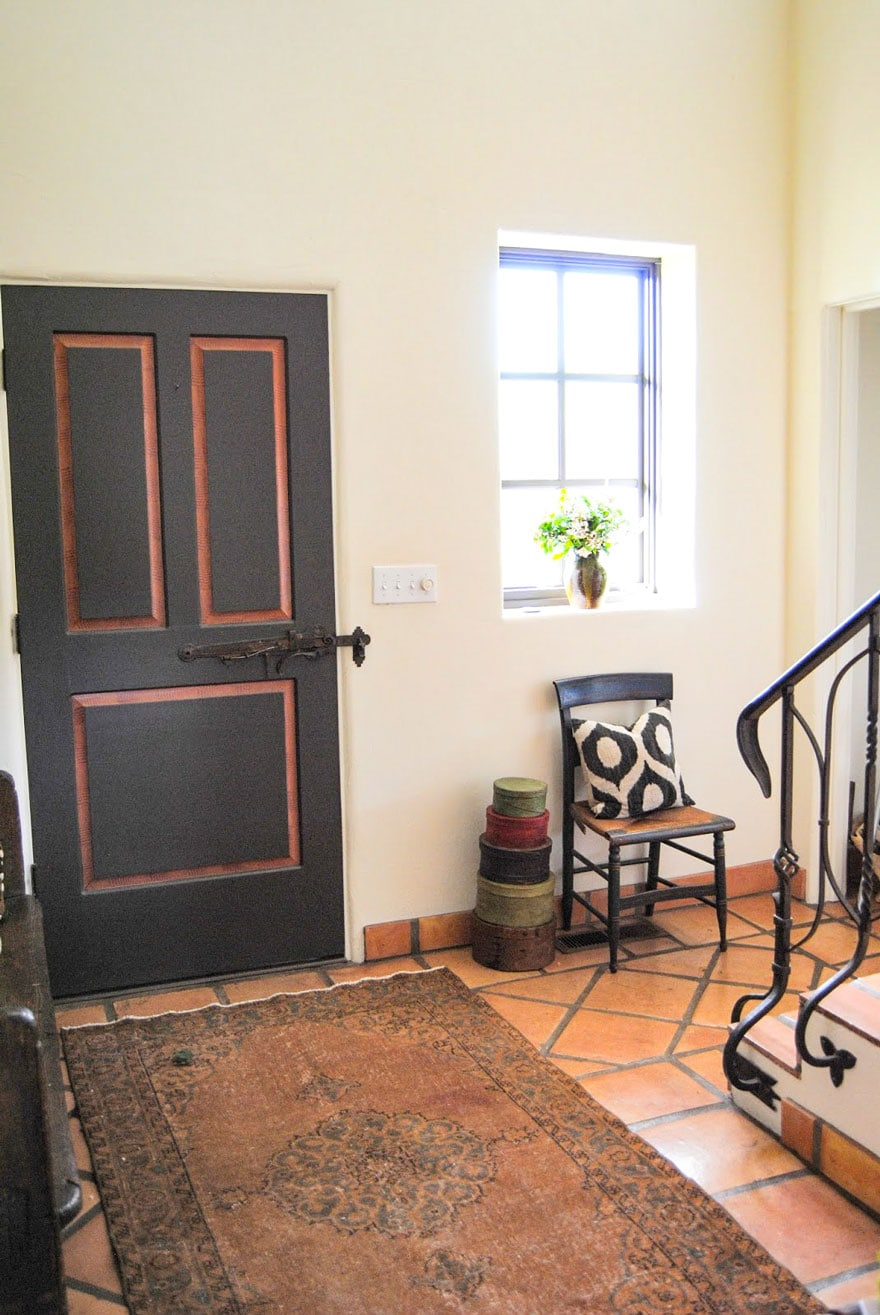 door, shaker boxes, chair, saltillo tile floor, window