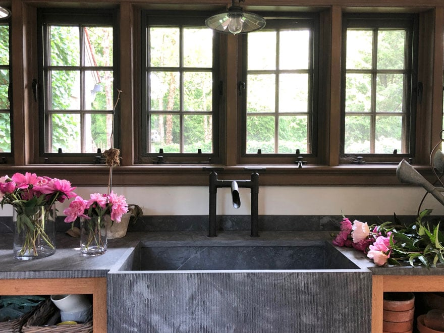 farm sink in potting shed with pink flowers