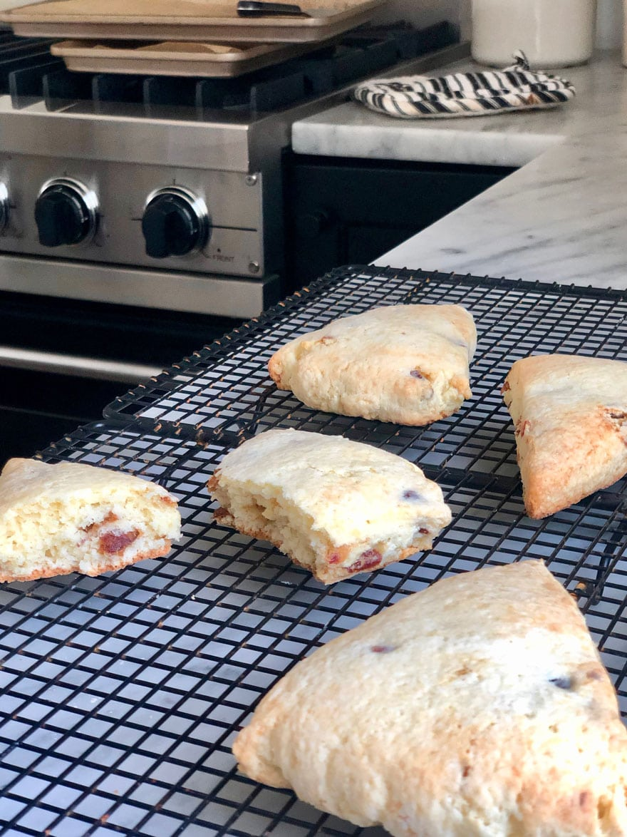 scones on wire rack with stove in background