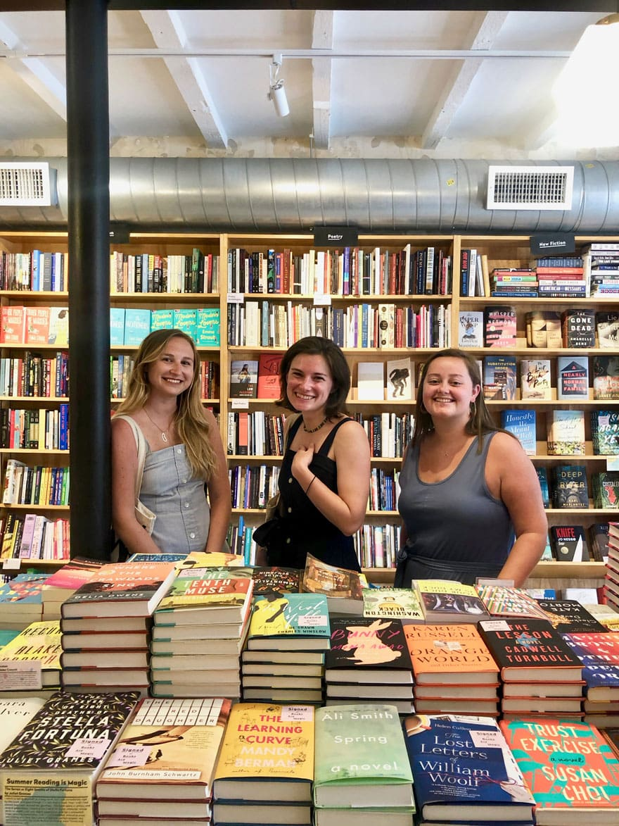 girls at book store in the stacks