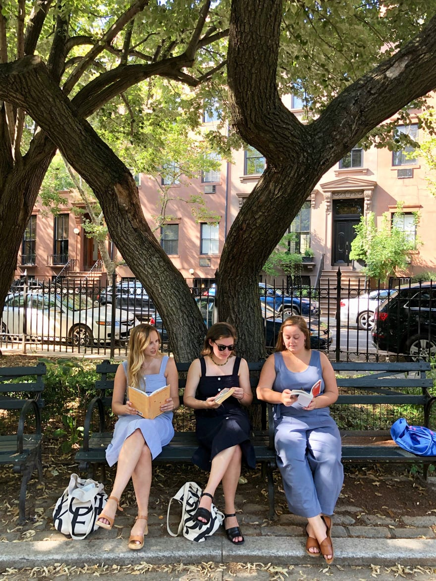 Three girls on park bench in Summer - Brooklyn, NY