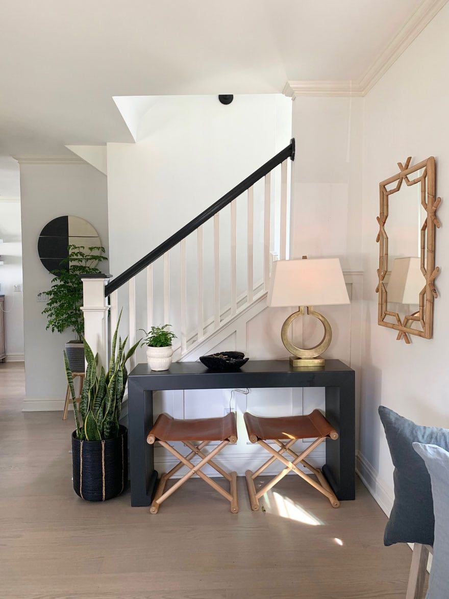 stools, table, lamp, plants, mirror, stairs