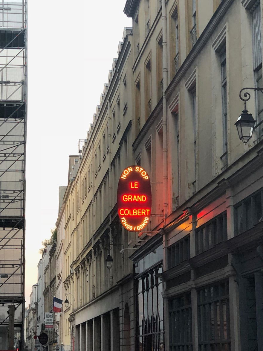 neon sign on paris street