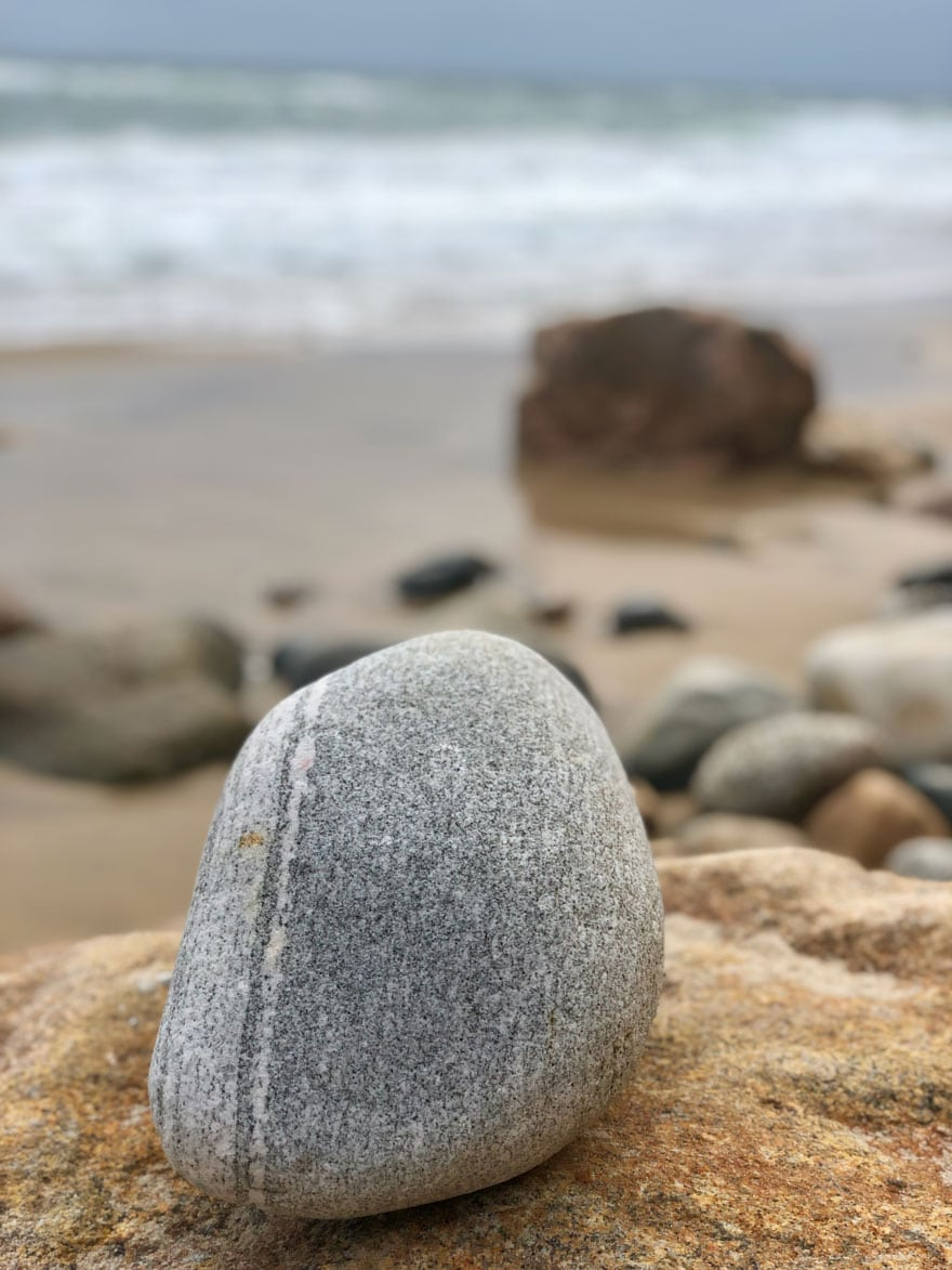 rock balancing on a larger rock