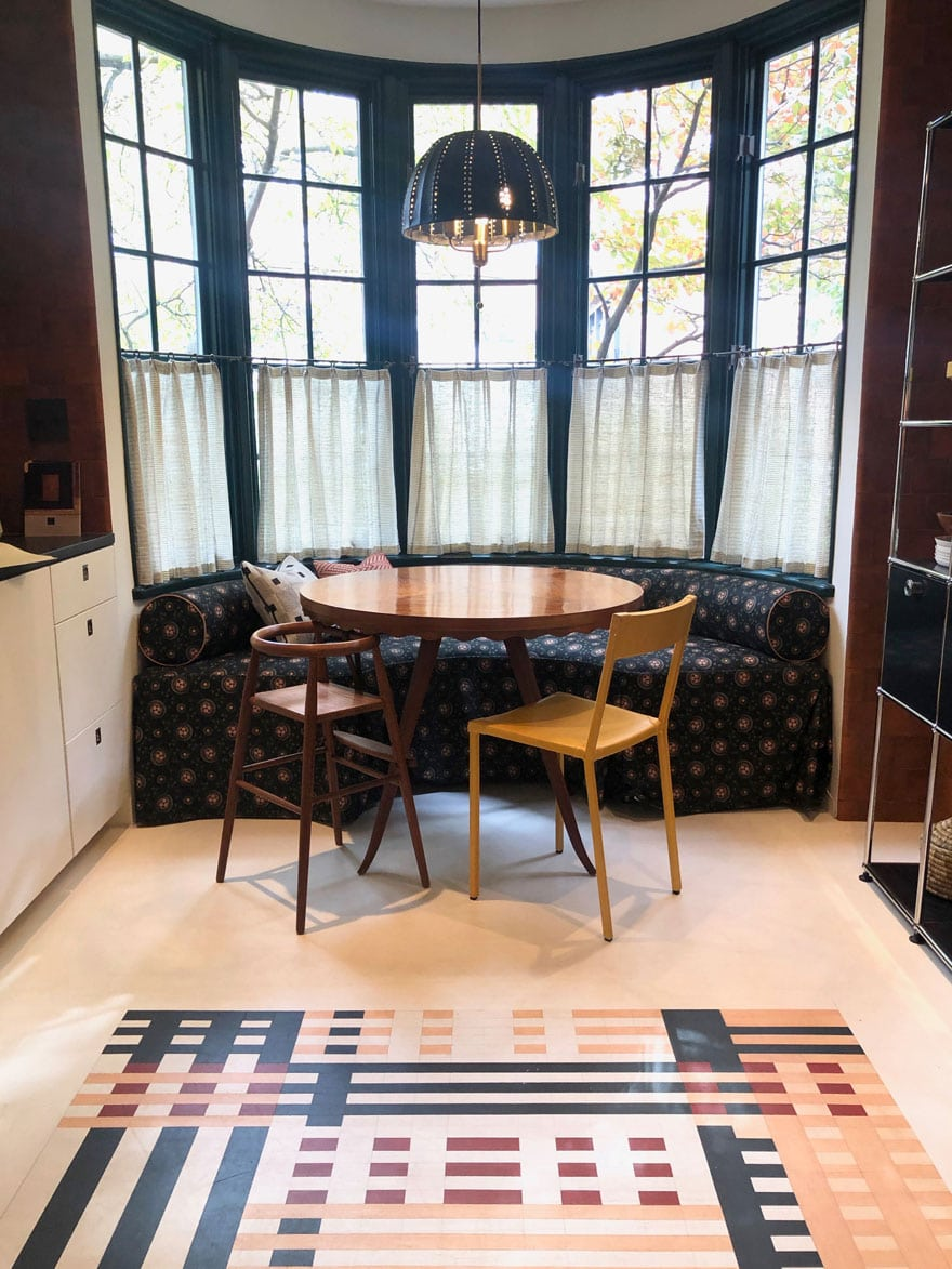 round table, pendant, chairs, painted patterned floor