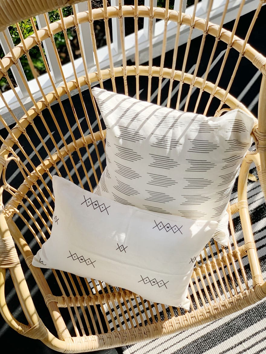 2 pillows on rattan hanging chair