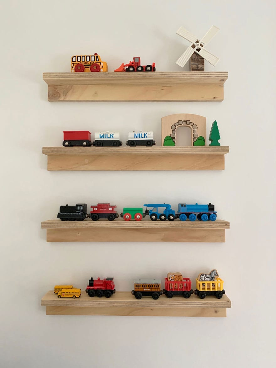 narrow wood shelves with small toys and trains