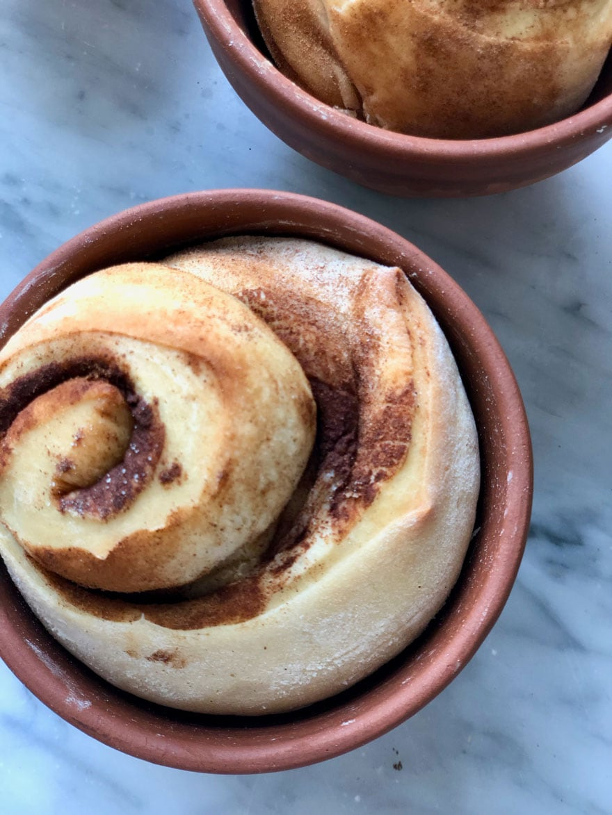 cinnamon bread in terra cotta pot on marble counter