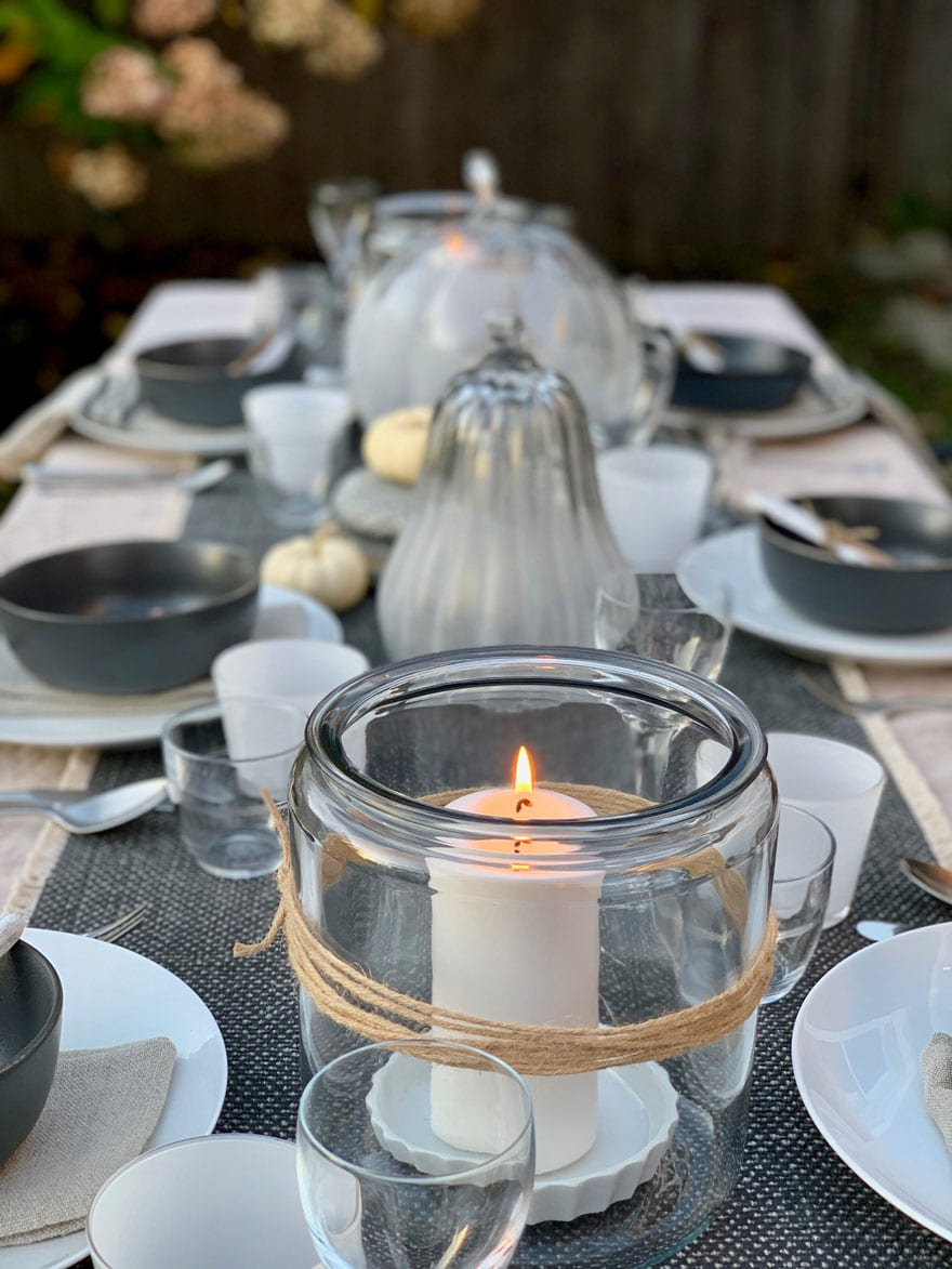candle in jar, dishes, plates, glasses