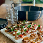 appetizer toasts on white board