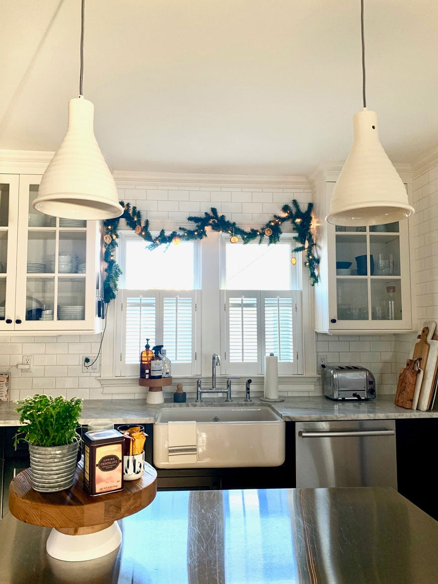 pendants over island, kitchen sink with holiday garland