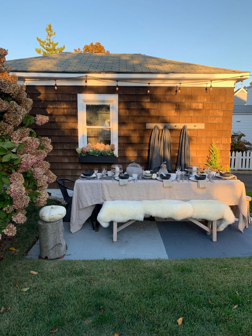 house with table setting outside