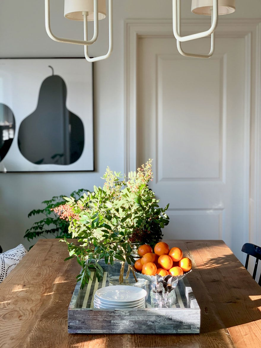 tray with branches and fruit on dining room table