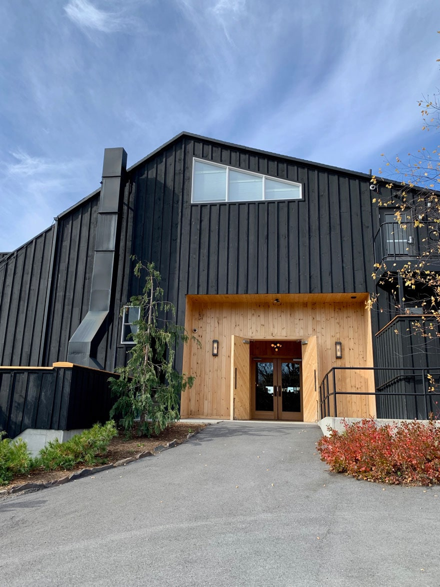 black and wood exterior with blue sky