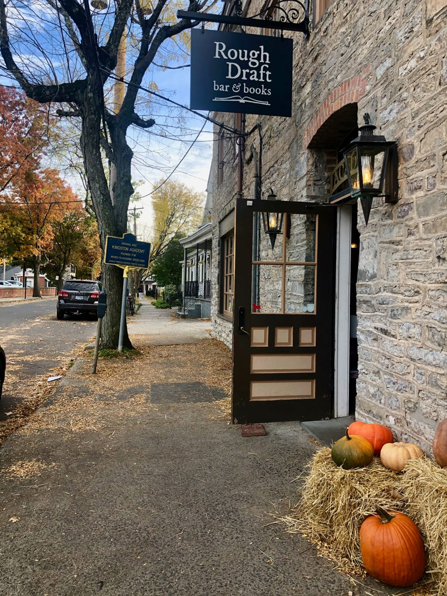 exterior of book store, pumpkins, sign, door open