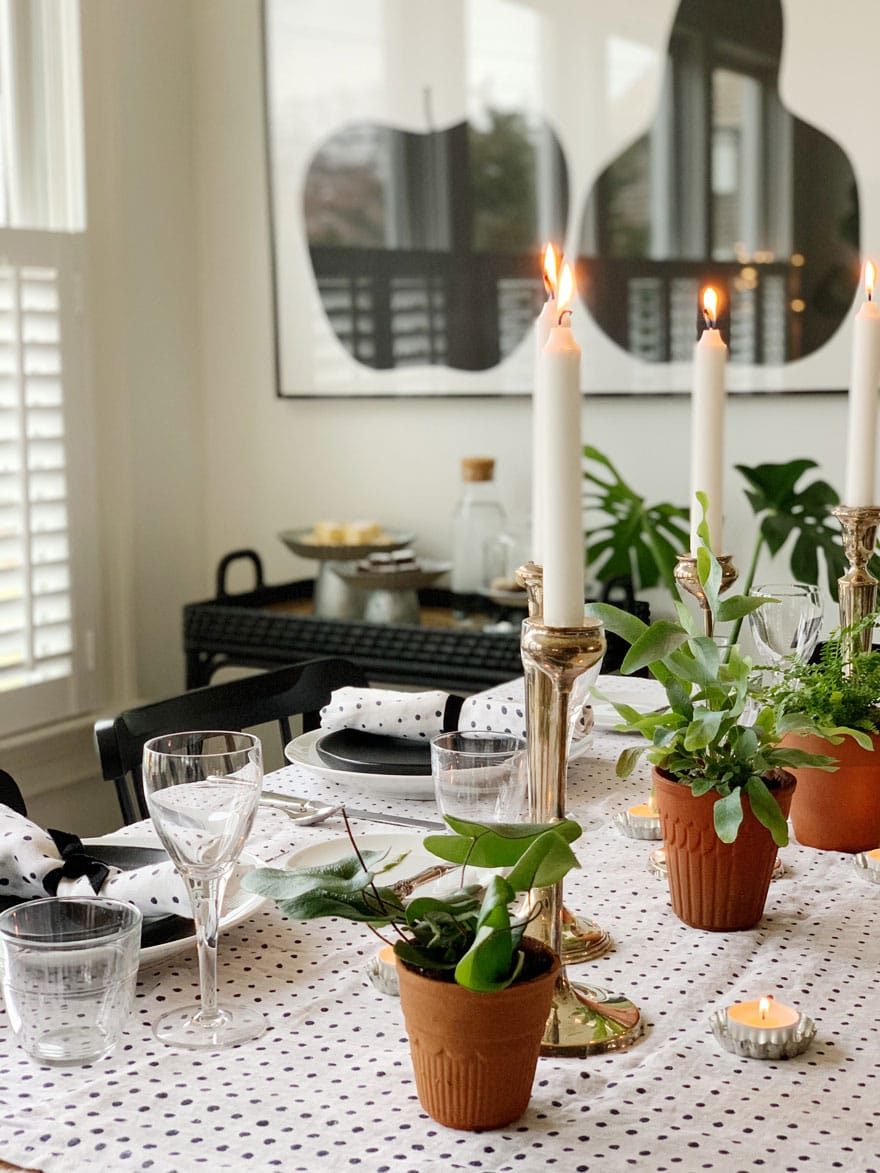 candles, plants, bar cart in a dining room