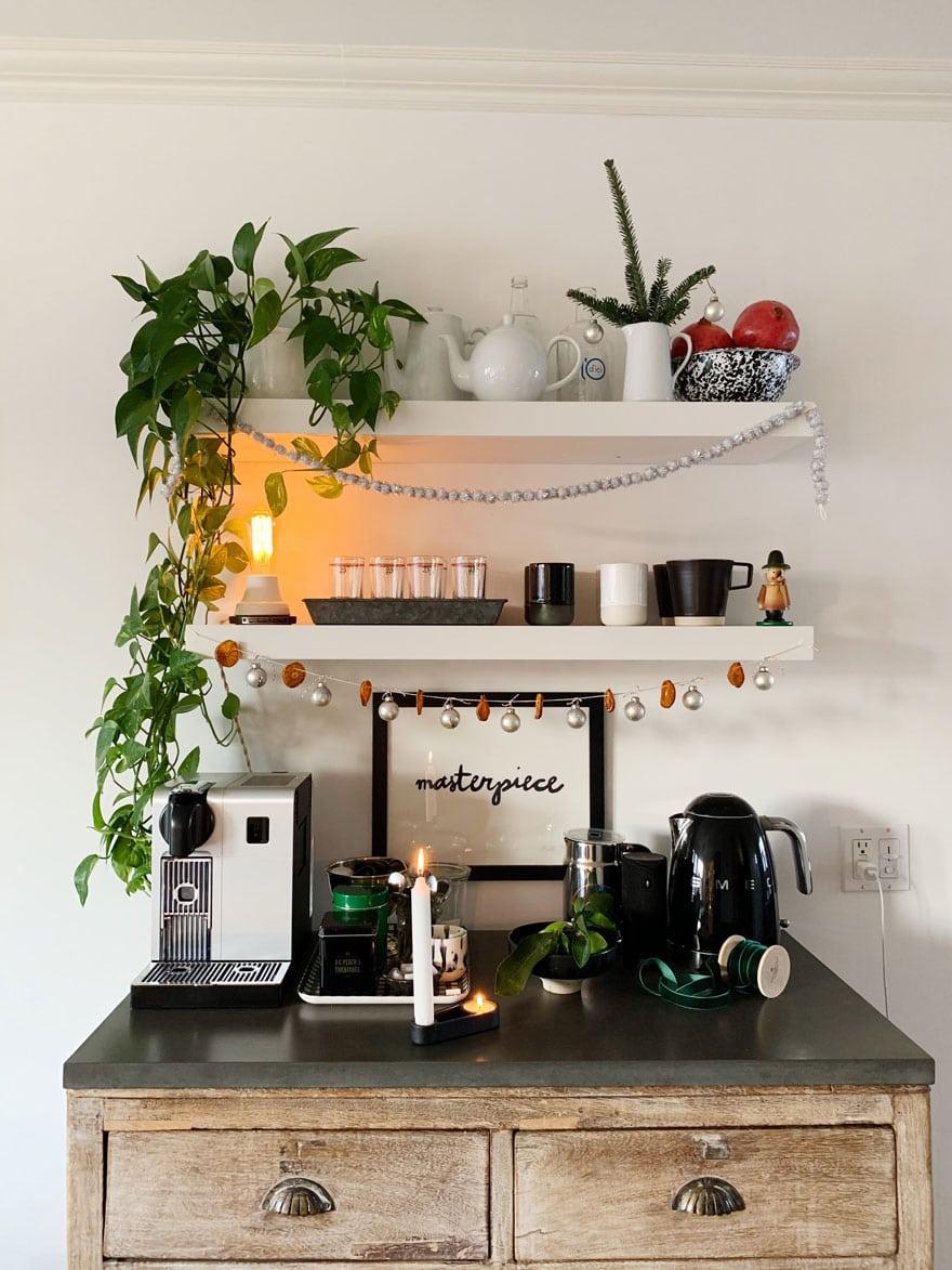 plant, coffee maker, shelves, hutch