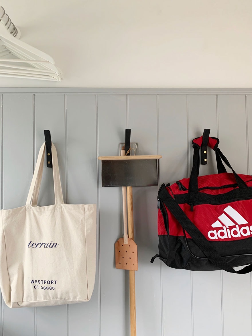 gray wall with red gym bag, dustpan