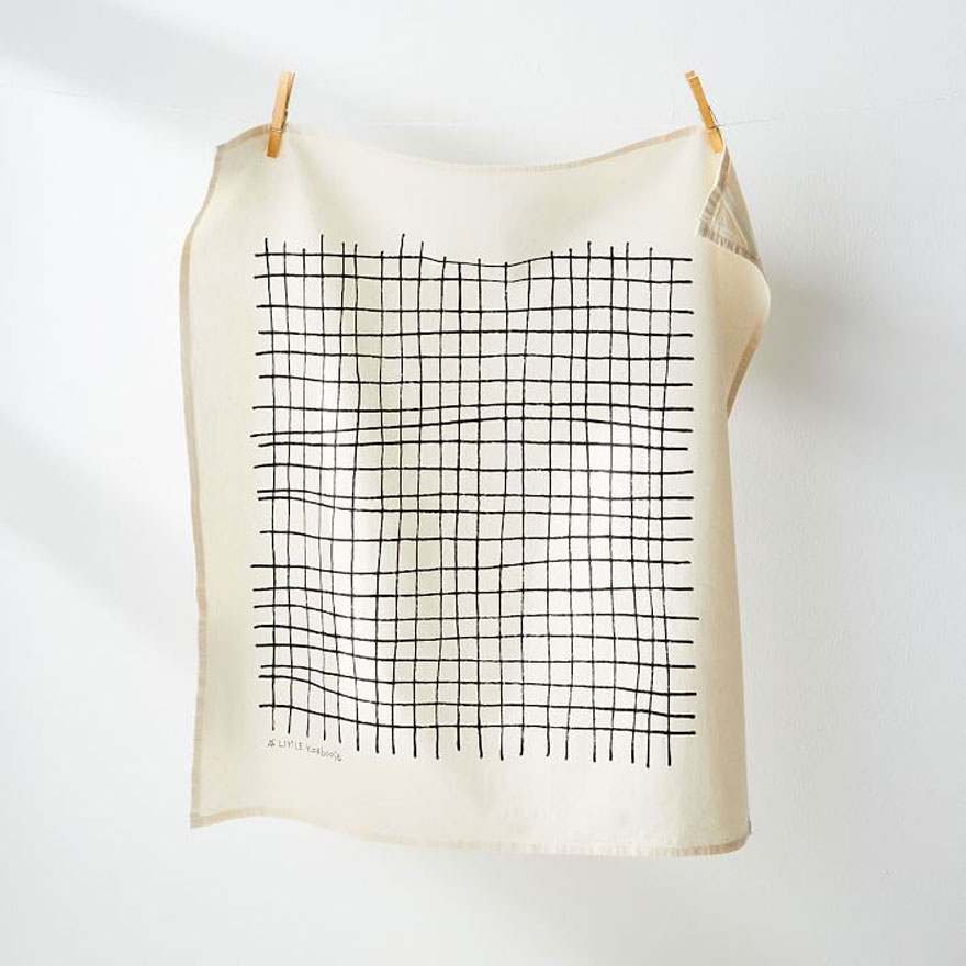 tea towel on line with wood clothespins