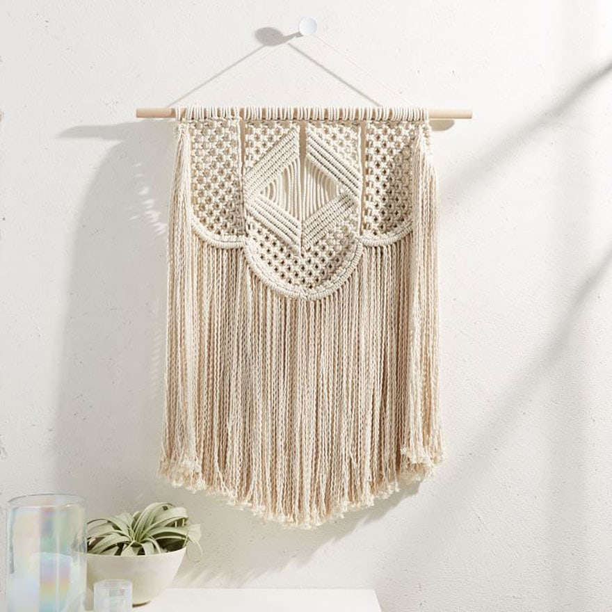 macrame wall hanging in cream and small air plant