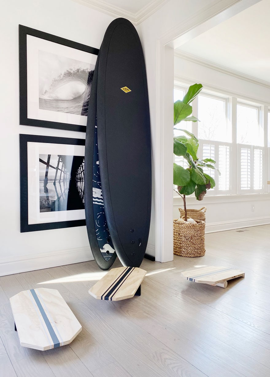 black surf boards in house with plant in basket