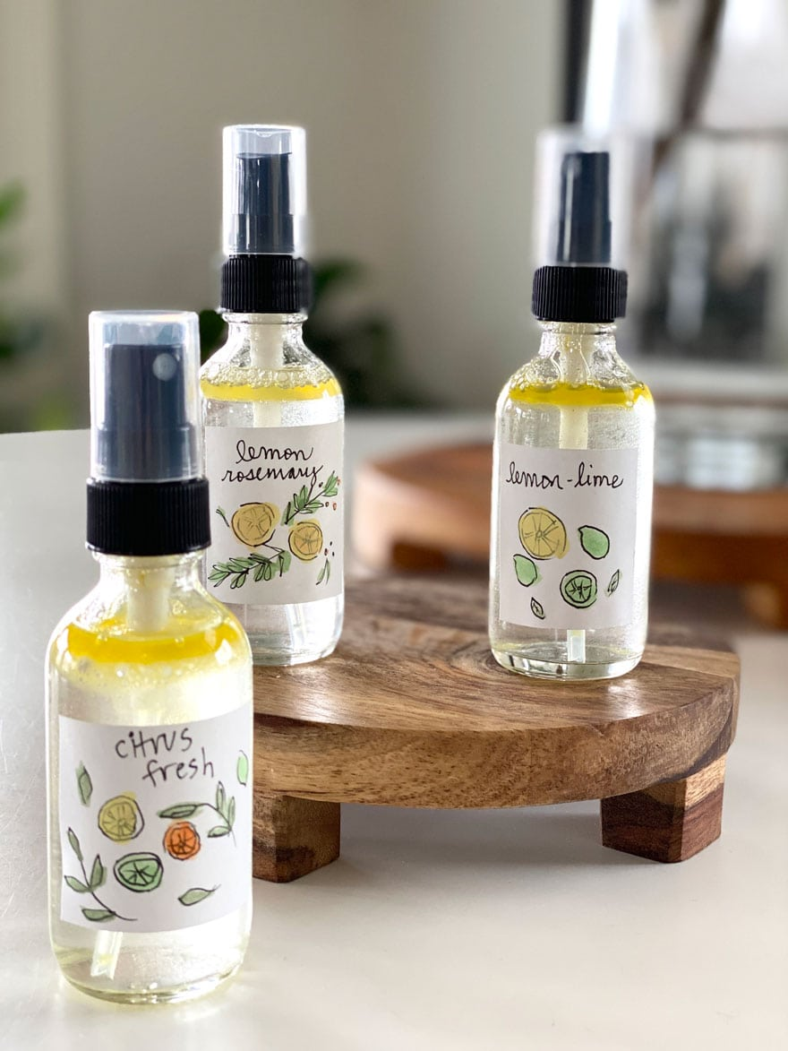 small bottles of room spray with diy tags