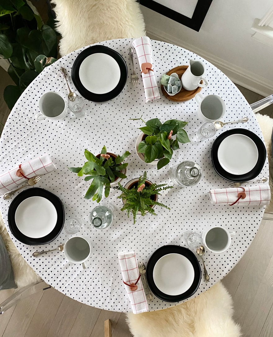 table setting for four on round table