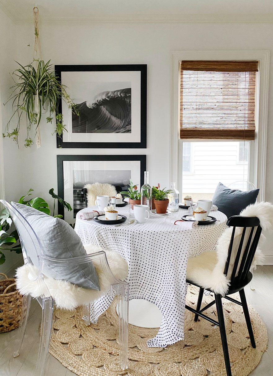 plants, round table with chairs and pillows and throws.