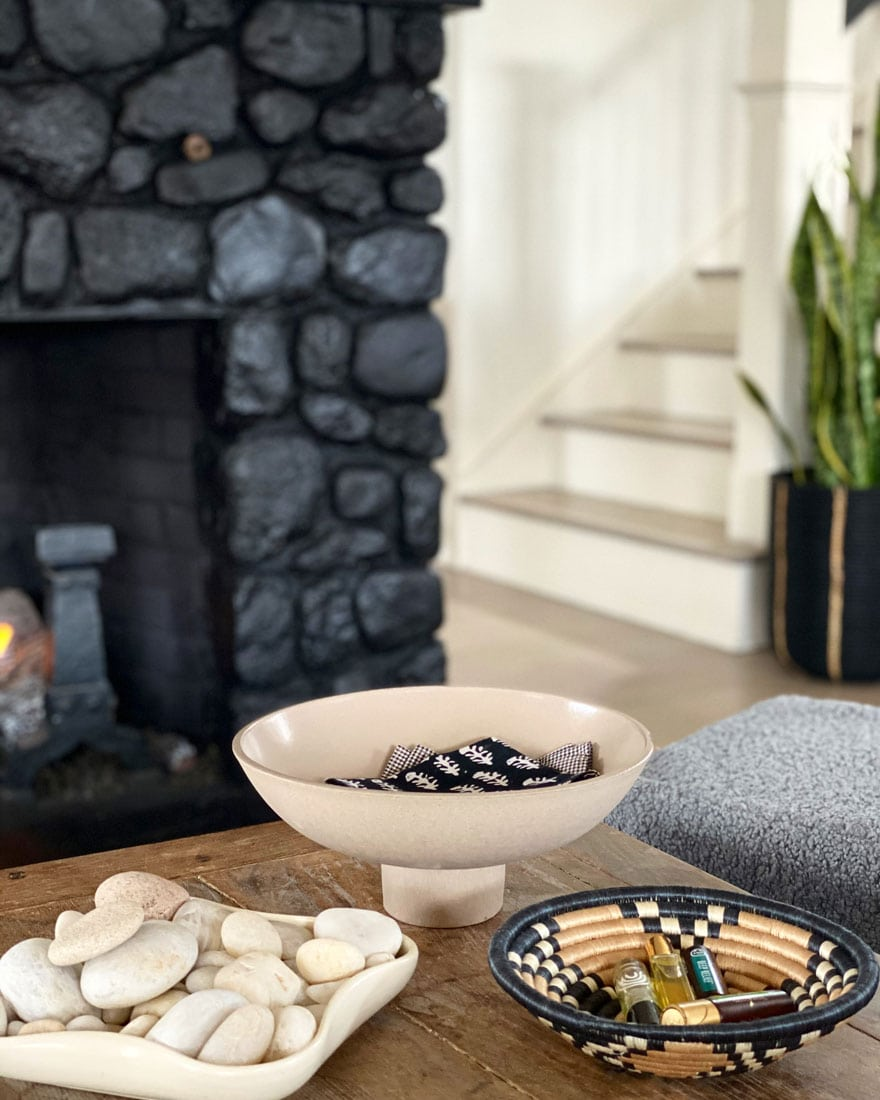 black stone fireplace with coffee table