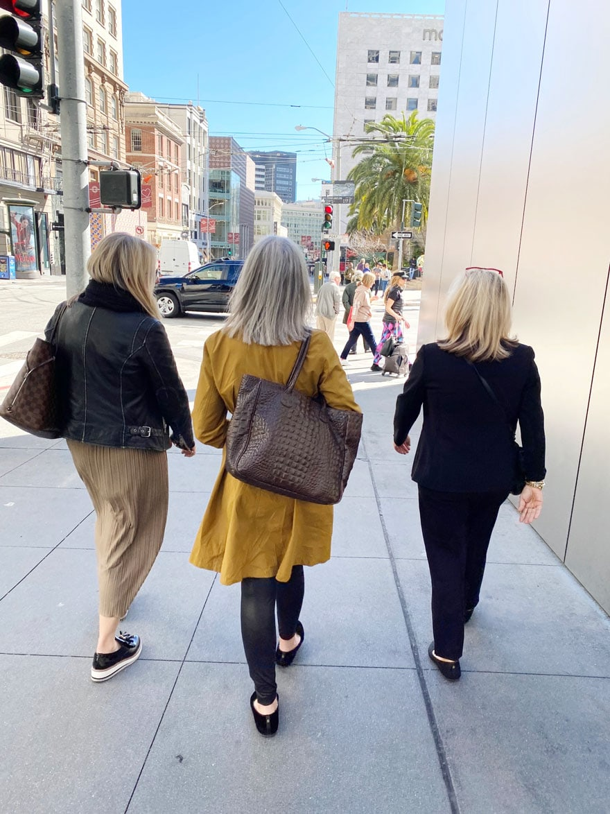 3 women walking from black in san Francisco