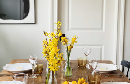 flowers on table with white dishes
