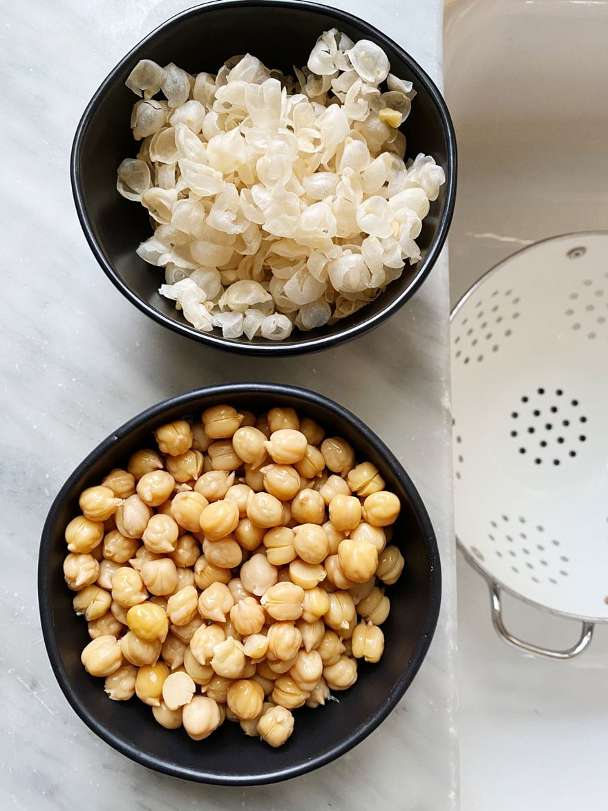 garbanzo beans and skin in small; black bowls