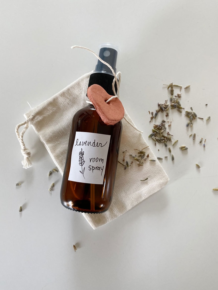 small amber bottle of lavender room spray with label