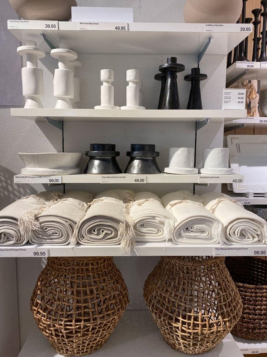 candlesticks, vases, basket on white shelves