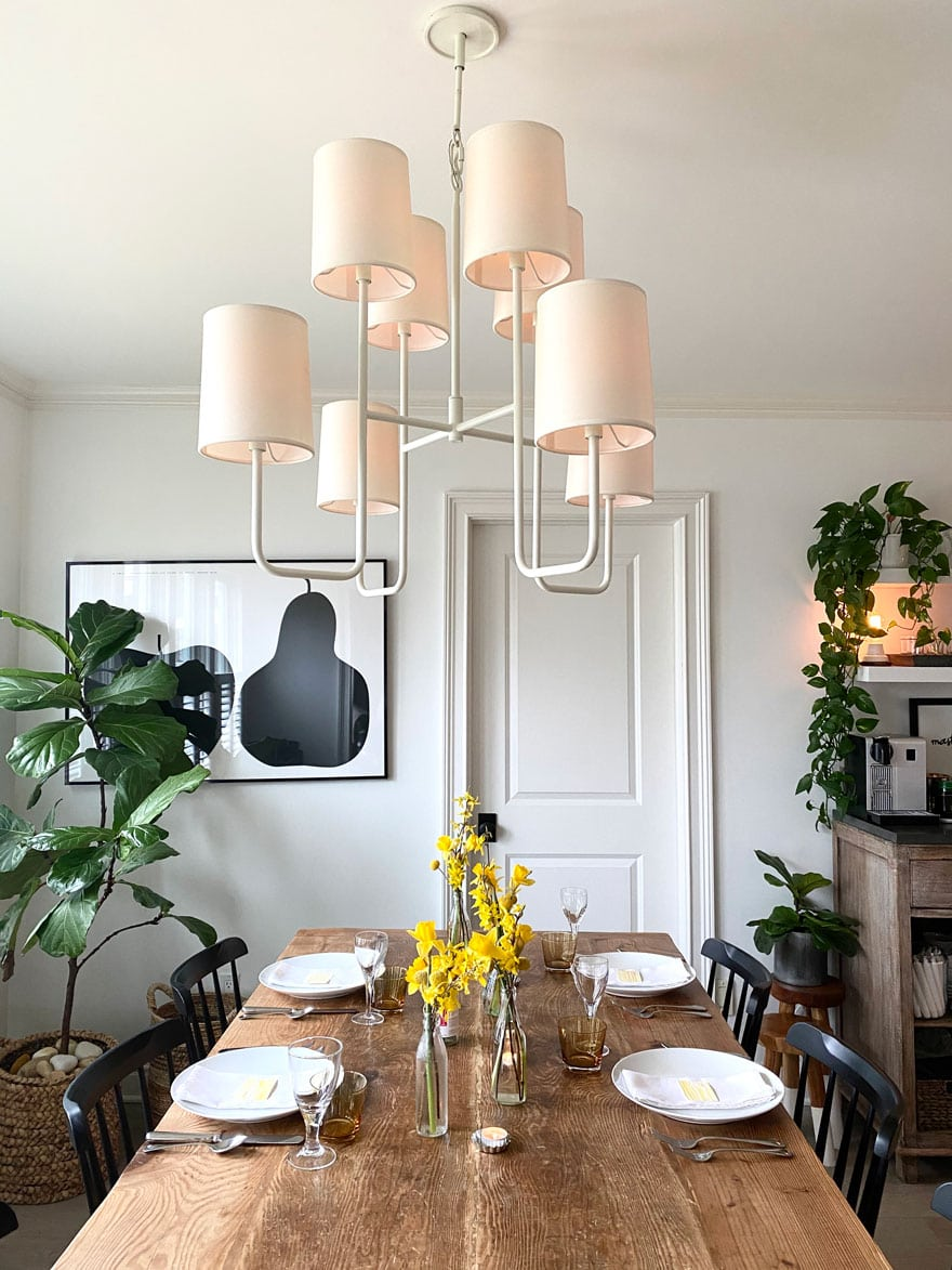 dining room with farm table, flowers, pendant