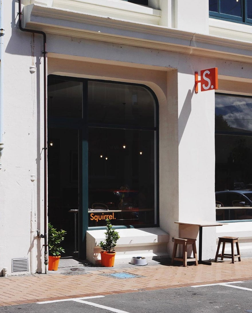 cafe exterior with orange sign