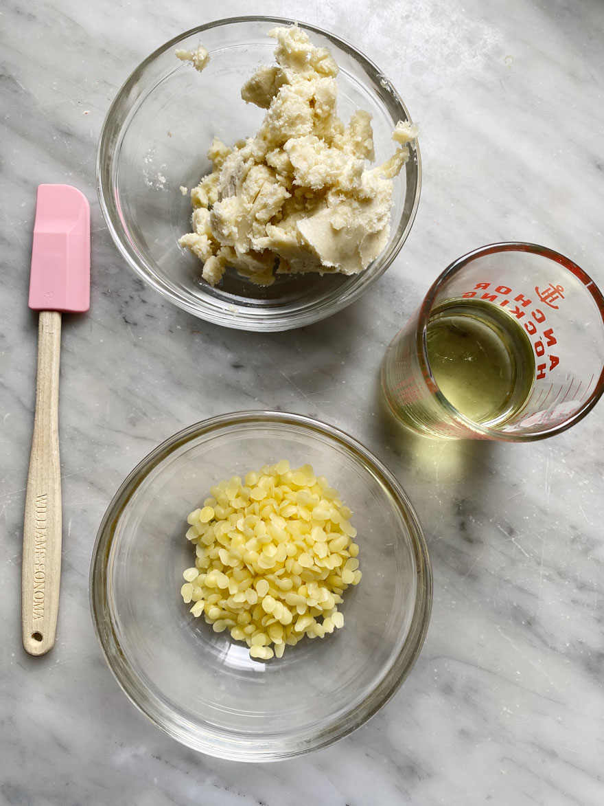 small glass bowls with ingredients and pink rubber spatula