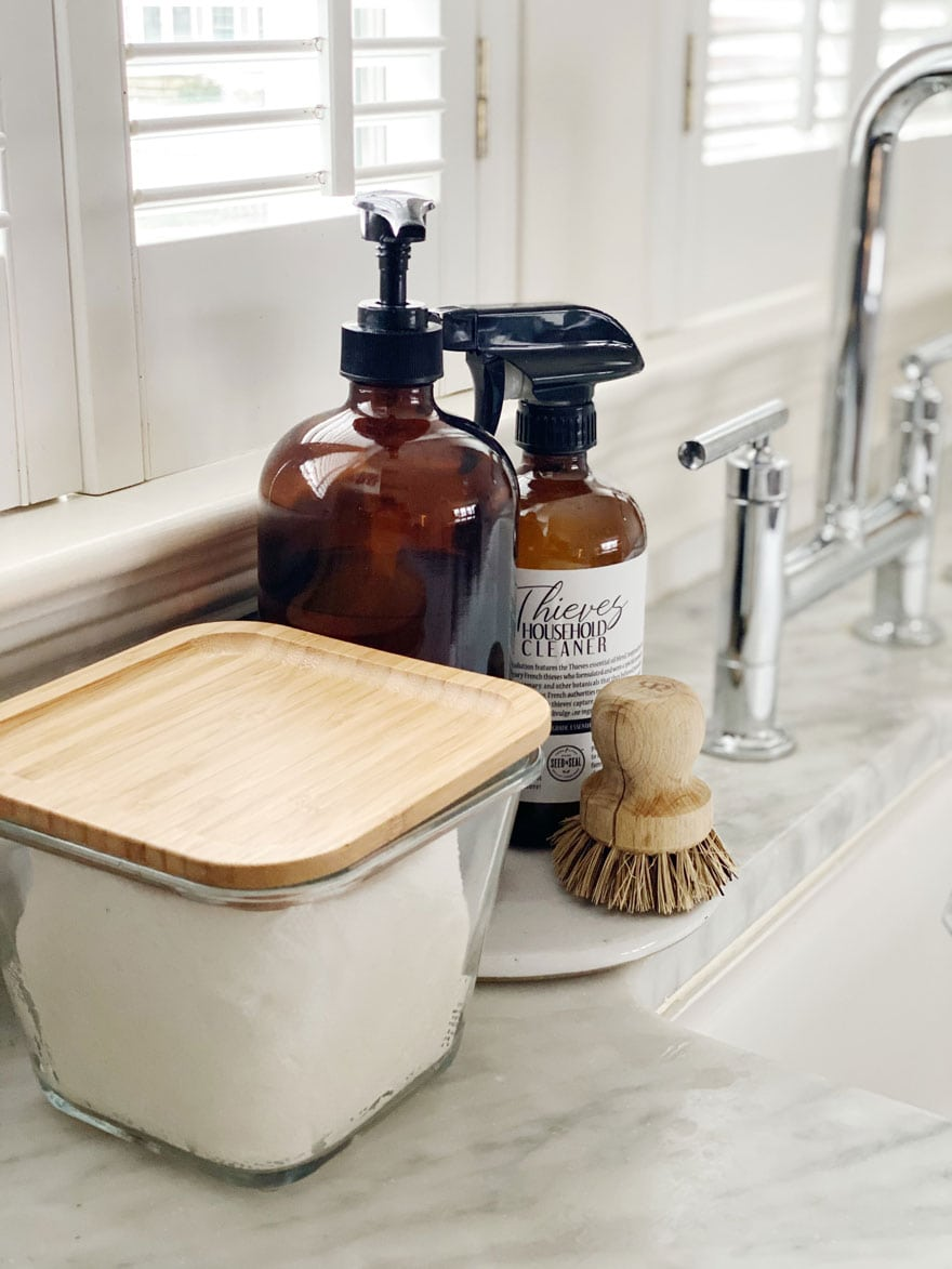 glass square jar with wood lid, bottles sink, faucet