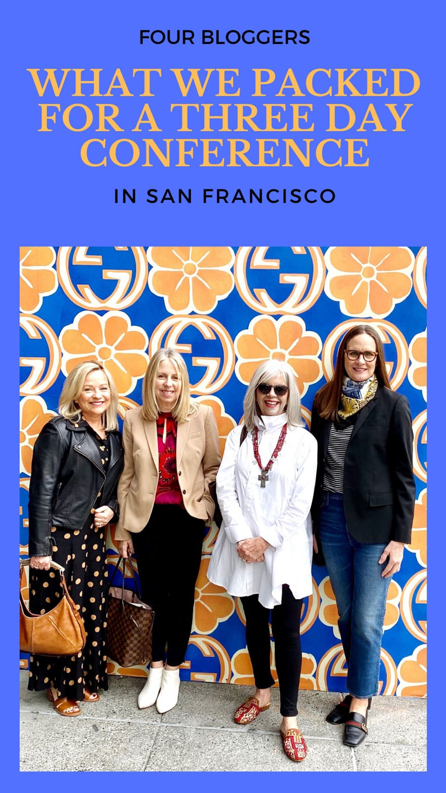 four women standing in front of a colorful pattern with text