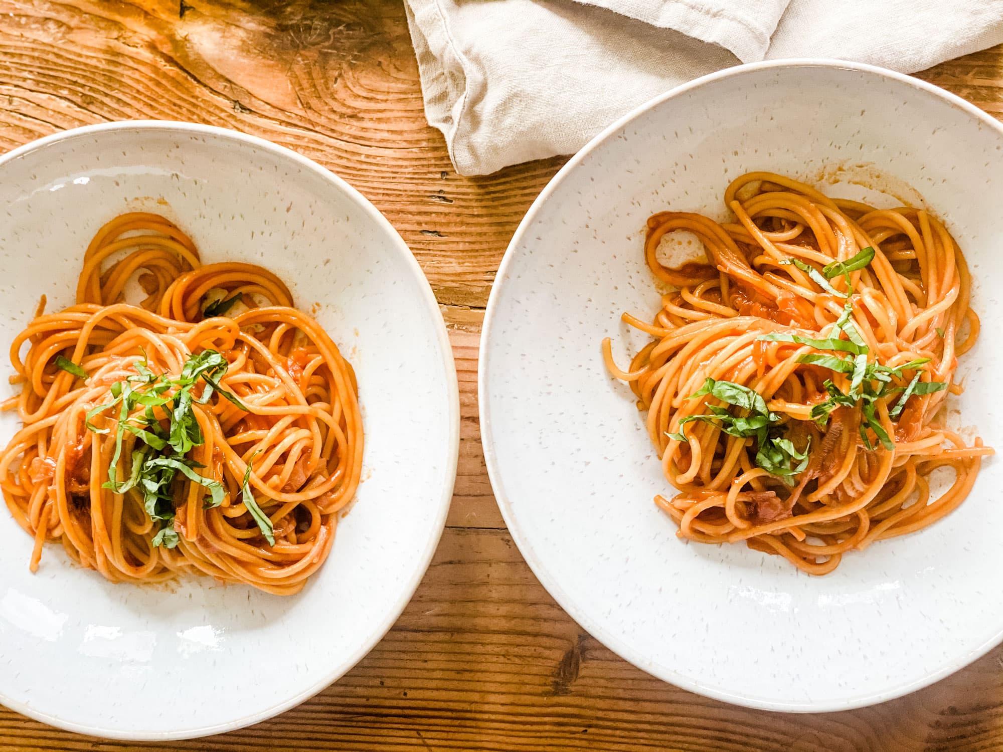 2 bowls of pasta with basil chiffonade