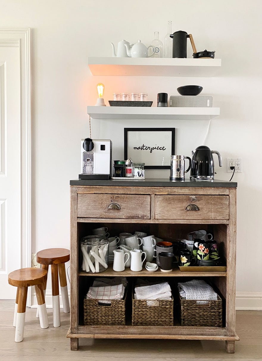 furniture set up as a coffee bar with open shelving above