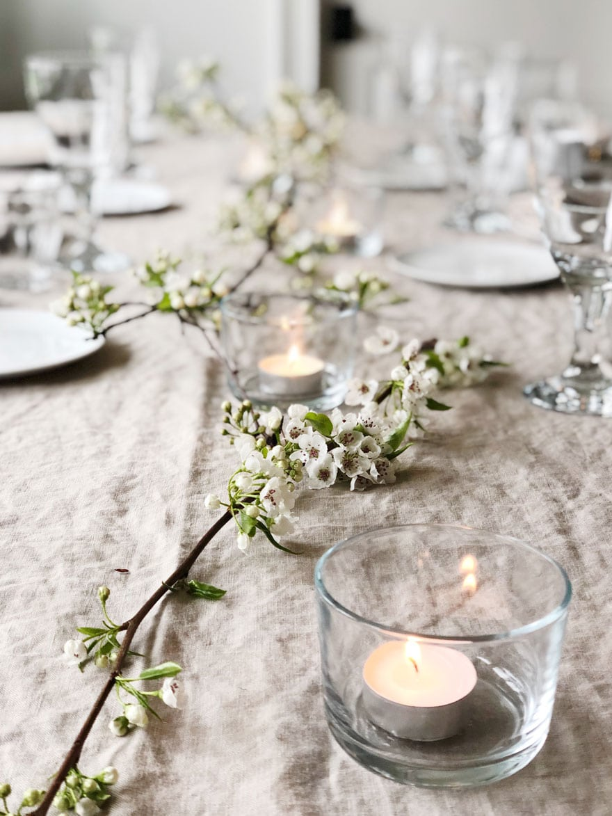 linen table cloth with branches and candles