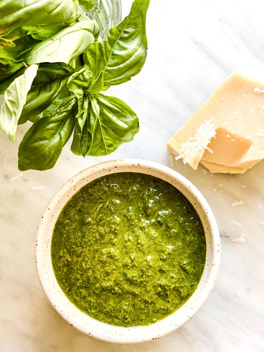 dish of basil pesto with basil leaves and cheese