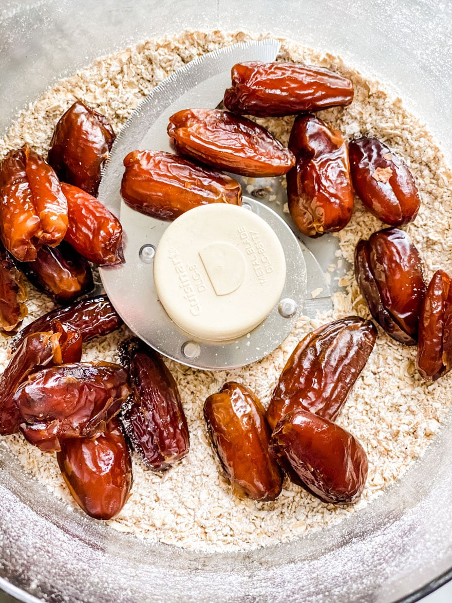dates in bowl of food processor with oats
